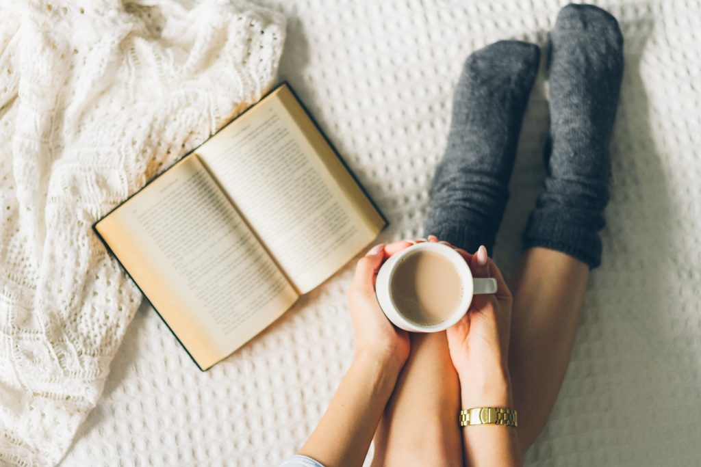 Woman,Laying,In,Bed,And,Read,Book,With,Cup,If