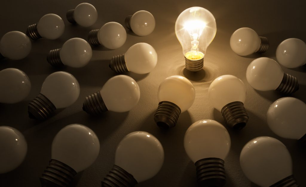 One,Lit,Bulb,Shines,On,Others,,Leader.