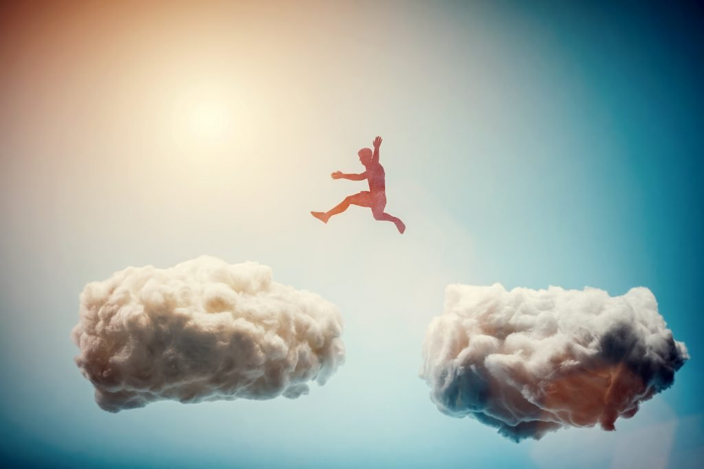 Man,Jumping,From,One,Cloud,To,Another.,Taking,Risks,And