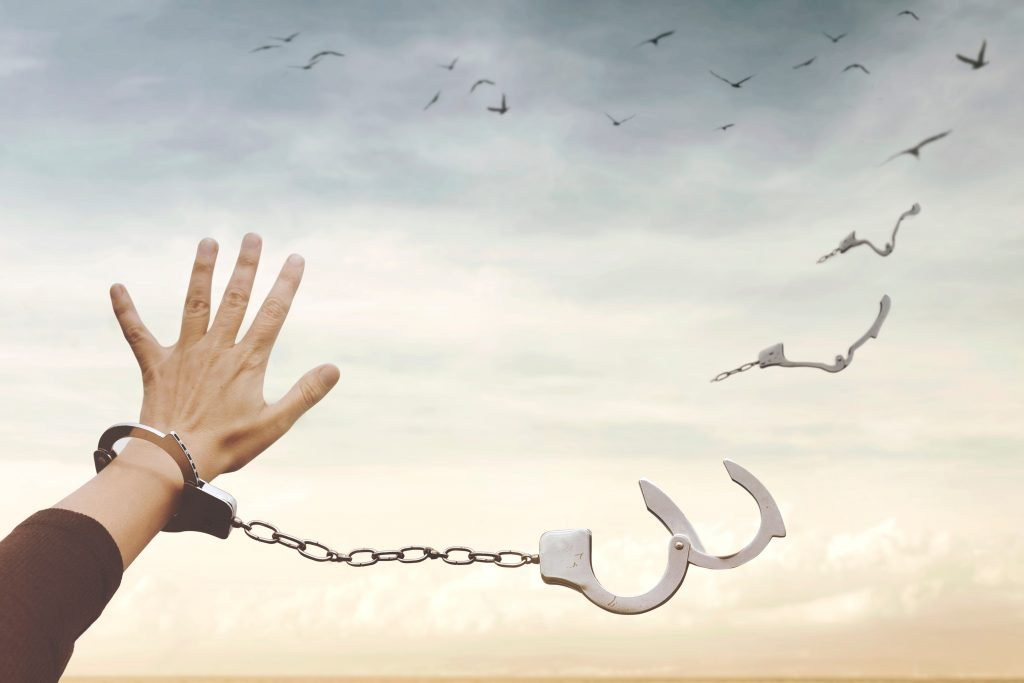 Conceptual,Image,Of,A,Broken,Handcuff,That,Turns,Into,Free